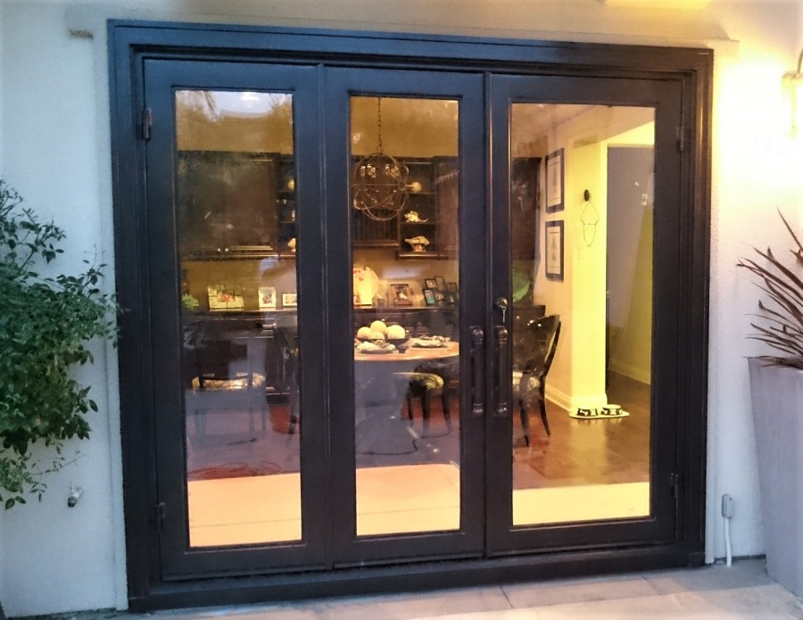 Folding triple Doors to back Patio. As shown 9\u0027-0 x 7\u0027-0 Clear Glass and Copper hand-Patina & RUSTIC 101 - Steel Glass and Iron Doors